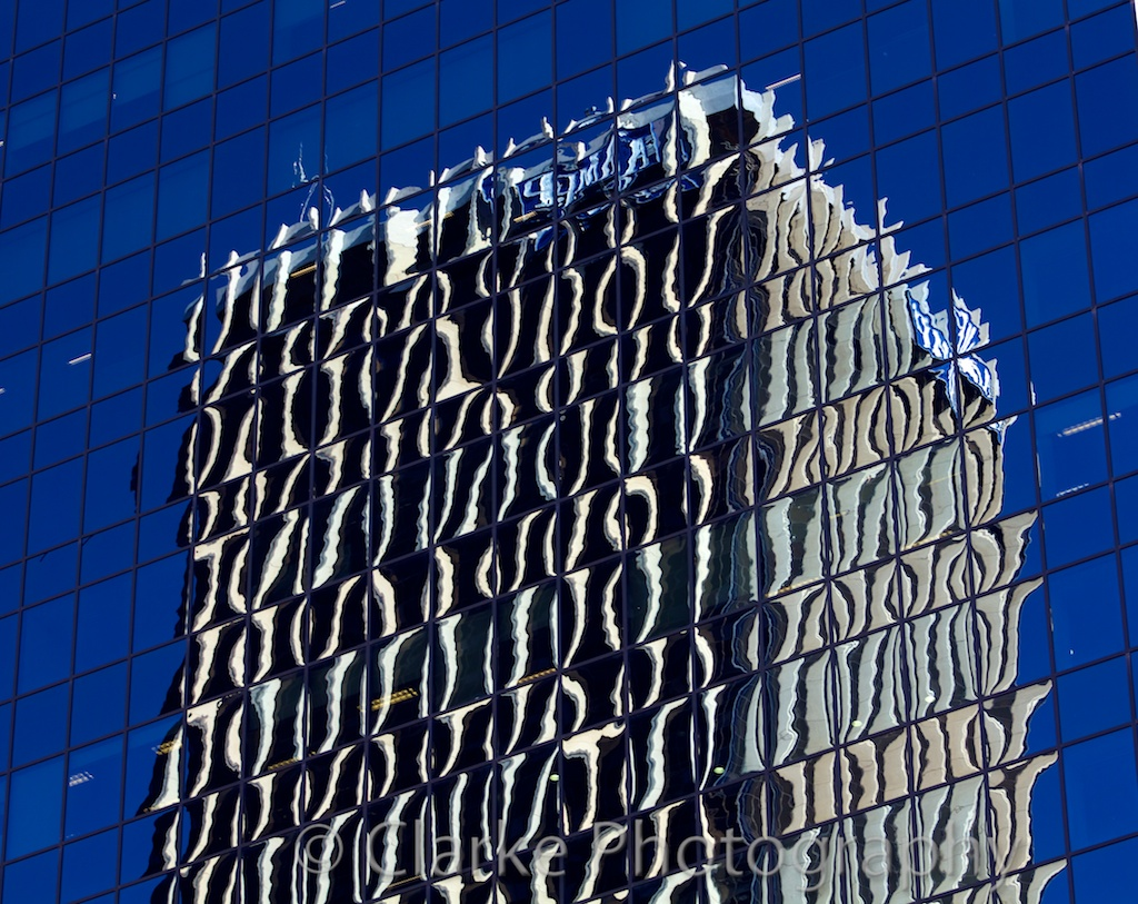 Reflections in a glass building with heavy glass distortions